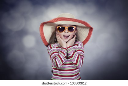 Happy summery girl wearing a hat and sunglasses
