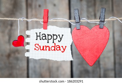 Happy sunday images stock photos vectors shutterstock happy sunday on instant paper and small red hearts hanging on the clothesline on old m4hsunfo