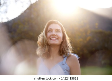 happy sunrise woman with beautiful smile full of optimism