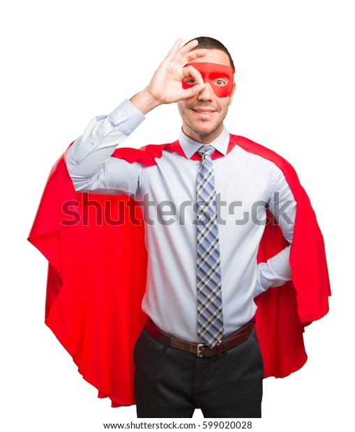 Happy super businessman doing a search gesture