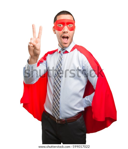 Happy super businessman doing a victory gesture
