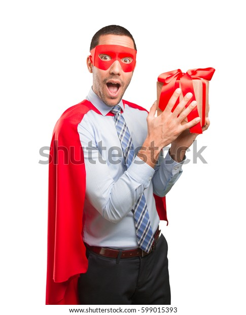 Happy super businessman with a gift