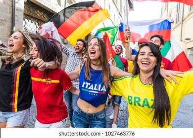 Happy supporters from different countries walking and chanting together. Fans from Italy, Germany, Spain, Brazil and other countries enjoying sport together. Sport, respect and fair play concepts