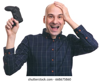 Happy surprised bald guy with a joystick Wins computer game. Isolated