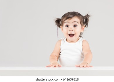 Happy and surprised child girl with excited expression