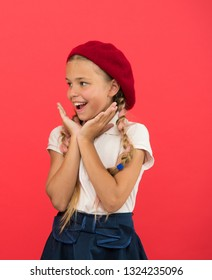 Happy and surprised. Fashion girl with tied hair into braids. Cute girl having trendy hairstyle. Little kid wearing stylish french beret. Small child with long hair plaits. French style girl.