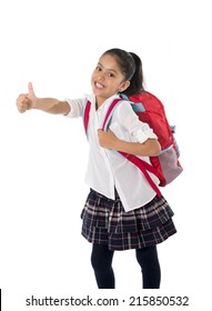 happy sweet little school girl carrying schoolbag backpack doing ok thumb up sign in education and back to school concept isolated on white background