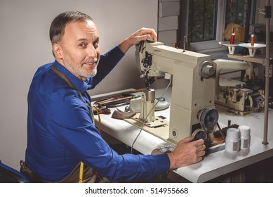 happy tailor working on the machine