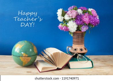 happy teacher's day, still life with asters bunch and books