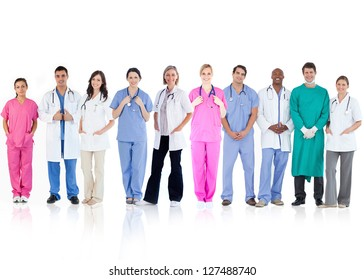 Happy team of doctors standing together in a line on a white background