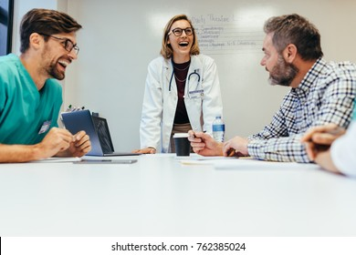 Happy team of healthcare professionals smiling during meeting. Staff meeting in hospital.