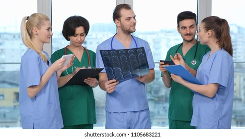 Happy Team of Medical Doctors Talking in Health Care Hospital, Teamwork Activity Concept