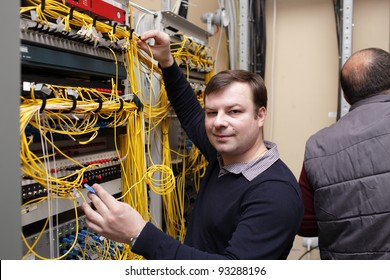 The happy technician posing at server room