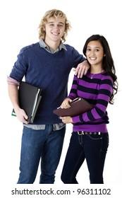 happy teen couple with school books
