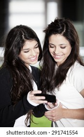 Happy teen friends with mobile phone