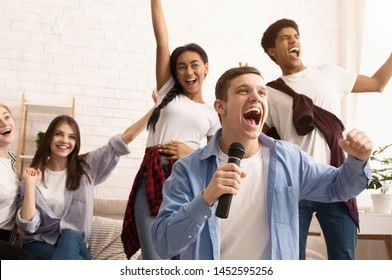 Happy teen friends singing songs, spending time together and having fun