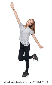 Happy teen girl in full length celebrating success with hands outstretched raised, isolated on white background