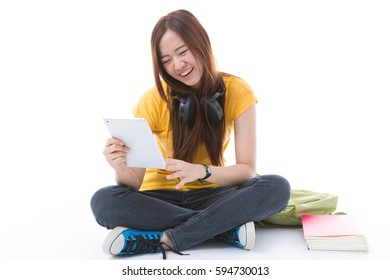 happy teen girl listening to music, full length, isolated on white