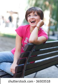 happy teen girl on the park bench