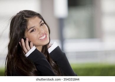 Happy teen girl smiling on the phone