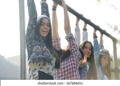 Happy teen girls having good fun time outdoors