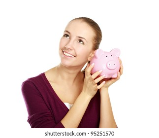 Happy teen holding a piggy bank and dollars