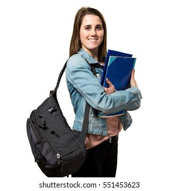 Happy teen student girl holding books