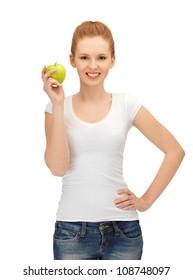 happy teenage girl with green apple.