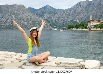 happy teenage girl with sailor hat and thumbs up on summer vacation