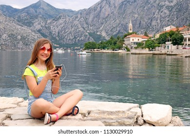 happy teenage girl with smart phone on summer vacation