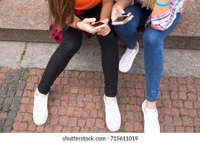 Happy teenage girls having fun spend time together in the city park. Summer time