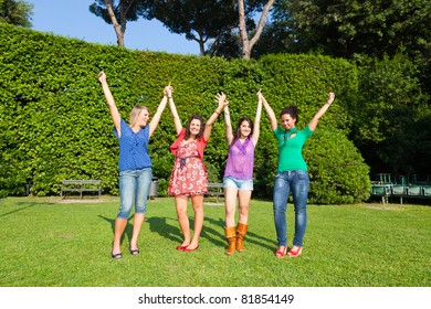 Happy Teenage Girls with Outstretched Arms