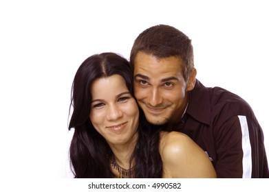 Happy teenage hispanic couple isolated over white background