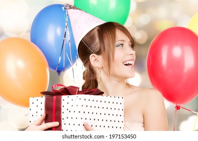 happy teenage party girl with balloons and gift box