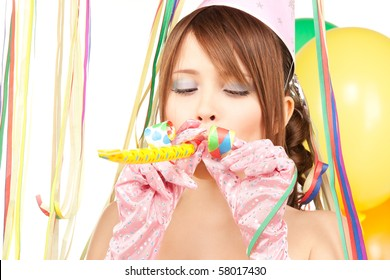 happy teenage party girl with balloons over white