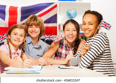 Happy teenage students at language courses