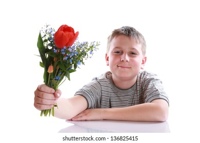Happy teenager with bouquet of flowers on a white background