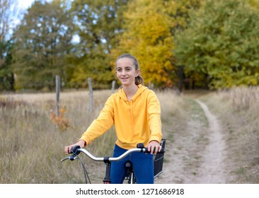 happy teenager driving with bicycle