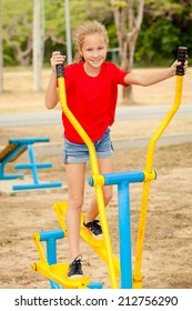 Happy teenager on the playground at the day time