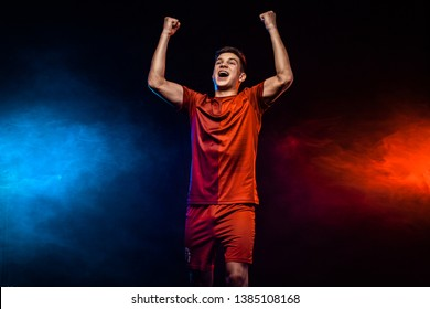 Happy teenager - soccer player. Boy in football sportswear after goal celebrating. Sport concept.