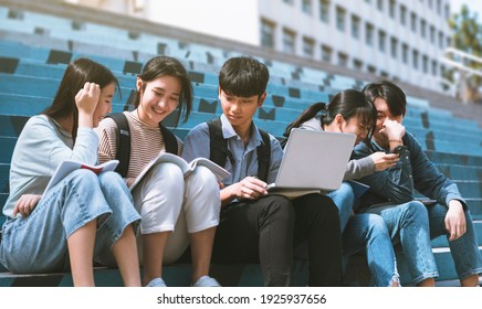 Happy Teenager Students talking and sitting On the Stairs