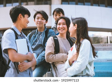 Happy Teenager Students talking and Walking On Stairs
