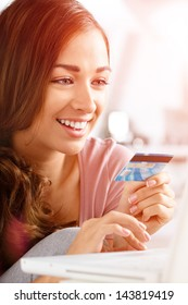 happy teenager woman using credit card shopping online laptop computer