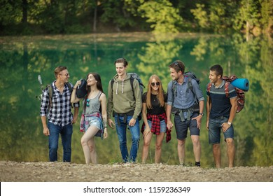 happy teenagers are going home after interesting days off in the nature. positive youth has got the inspiration from the nature