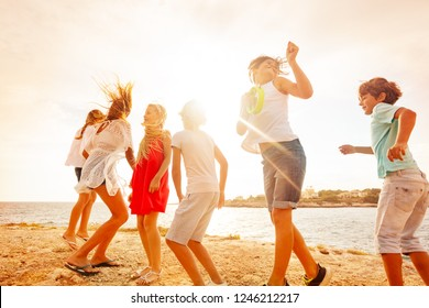 Happy teenagers having fun during beach party