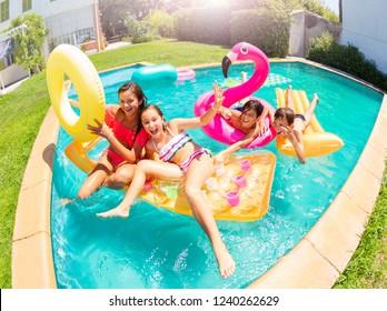 Happy teenagers having fun in swimming pool