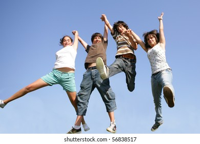 Happy teenagers jumping in the air