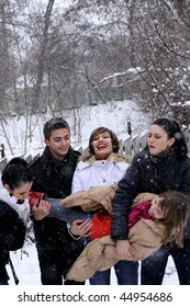 happy teenagers playing in snow