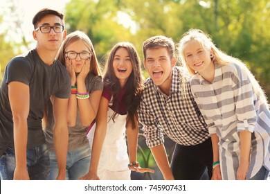 Happy teenagers posing on city street