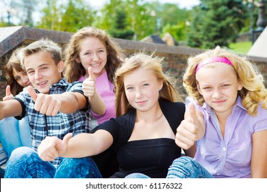 Happy teenagers showing thumb up